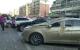 昨夜风大,中心城墙体脱落,砸到两辆停放停车场的轿车。如果下面有人,后果不堪设想。